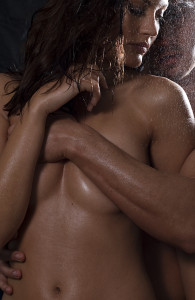 Loving nude couple engaging in sexual games